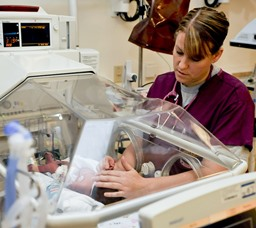 Circle AK Neonatal Nurse with newborn baby